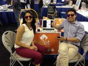 """Virji (left) and Chowdhury of Ribbet at the Innovation Cluster's """"Innovation Zone"""" at the LoveLocalPTBO show"""